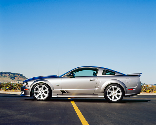 MST 02 RK0047 01 © Kimball Stock 2005 Ford Mustang Saleen Silver Side View On Pavement Blue Sky