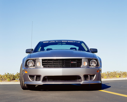 MST 02 RK0049 04 © Kimball Stock 2005 Ford Mustang Saleen Silver Head On Shot On Pavement Blue Sky