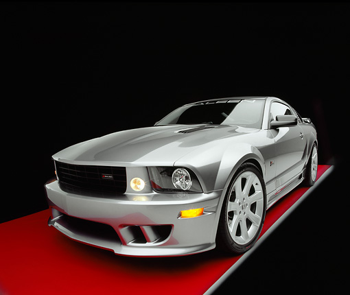 MST 02 RK0055 08 © Kimball Stock 2005 Ford Saleen Mustang Supercharged Silver Wide Angle 3/4 Front View On Red Floor Gray Line Studio
