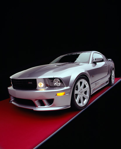 MST 02 RK0056 04 © Kimball Stock 2005 Ford Saleen Mustang Supercharged Silver Wide Angle 3/4 Front View On Red Floor Gray Line Studio