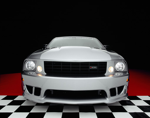 MST 02 RK0057 07 © Kimball Stock 2005 Ford Saleen Mustang Supercharged Silver Wide Angle Head On Shot On Checkered Floor Studio