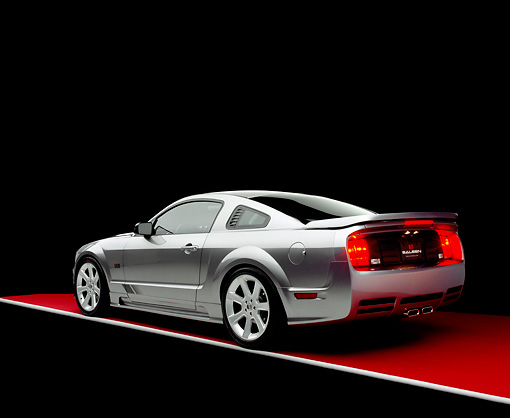 MST 02 RK0060 05 © Kimball Stock 2005 Ford Saleen Mustang Supercharged Silver 3/4 Rear View On Red Floor Gray Line Studio