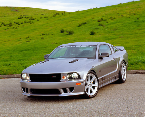 MST 02 RK0067 01 © Kimball Stock 2005 Ford Saleen Mustang Supercharged Silver 3/4 Front View On Pavement By Grass Hills