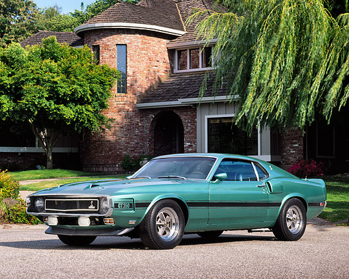 MST 03 RK0062 04 © Kimball Stock 1969 Ford Mustang Shelby GT350 Teal Green 3/4 Side View On Pavement By Brick House