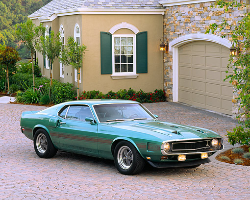 MST 03 RK0069 01 © Kimball Stock 1969 Ford Mustang Shelby GT350 Teal Green 3/4 Front View On Driveway By House