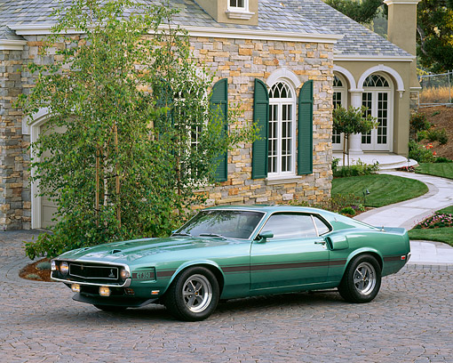 MST 03 RK0070 03 © Kimball Stock 1969 Ford Mustang Shelby GT350 Teal Green 3/4 Side View On Driveway By House