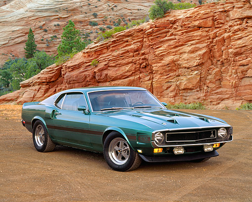 MST 03 RK0072 01 © Kimball Stock 1969 Ford Mustang Shelby GT350 Teal Green 3/4 Front View On Dirt By Red Rock