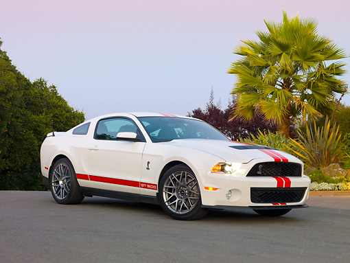 MST 03 RK0894 01 © Kimball Stock 2011 Shelby Ford Mustang GT500 White With Red Stripe 3/4 Front View On Pavement By Trees