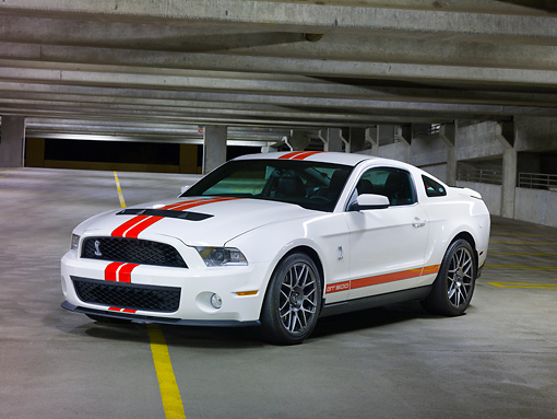 MST 03 RK0895 01 © Kimball Stock 2011 Shelby Ford Mustang GT500 White With Red Stripe 3/4 Front View In Parking Garage At Night