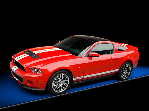 MST 03 RK0902 01 © Kimball Stock 2011 Shelby Ford Mustang GT500 SVT Red With White Stripes 3/4 Side View In Studio