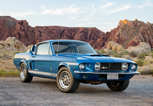 MST 03 RK0930 01 © Kimball Stock 1967 Ford Shelby Mustang GT 500 Blue 3/4 Front View On Dirt Road In Desert