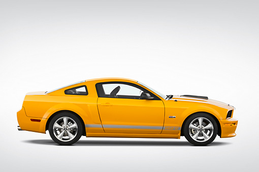MST 03 IZ0006 01 © Kimball Stock 2009 Ford Mustang Shelby GT Coupe Yellow Profile View Studio