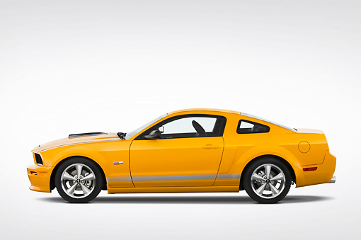 MST 03 IZ0007 01 © Kimball Stock 2009 Ford Mustang Shelby GT Coupe Yellow Profile View Studio