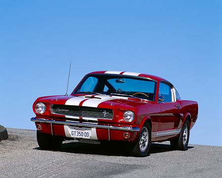 MST 03 RK0005 05 © Kimball Stock 1966 Ford Mustang Shelby GT350 Red With White Stripes 3/4 Front View On Pavement Against Blue Sky