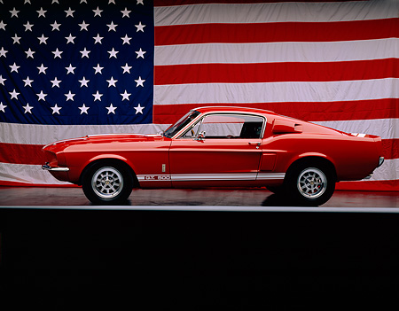 MST 03 RK0011 03 © Kimball Stock 1967 Ford Mustang Shelby GT500 Red White Stripe Profile On Gray Line American Flag