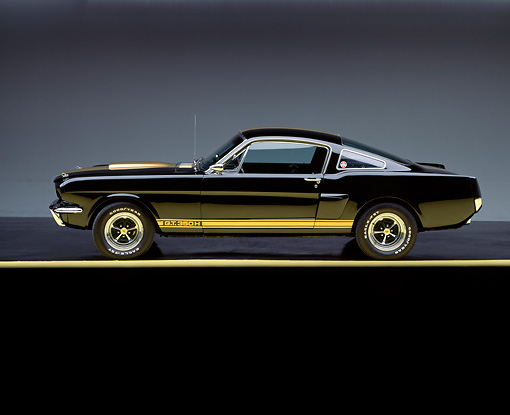MST 03 RK0024 01 © Kimball Stock 1966 Ford Mustang Shelby GT 350 Black Yellow Stripe Side View On Yellow Line Studio
