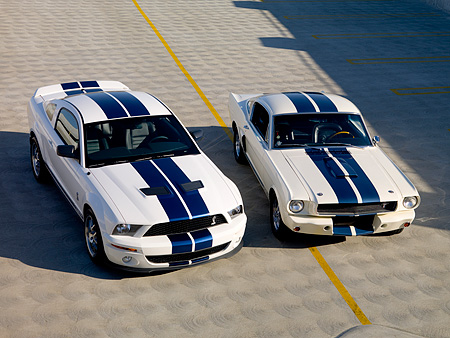 MST 03 RK0153 01 © Kimball Stock 2007 GT500 And 1966 GT350 Ford Shelby White Blue Stripe Overhead 3/4 Front On Pavement