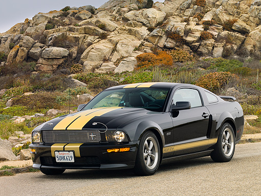 MST 03 RK0171 01 © Kimball Stock 2006 Ford Shelby GT-H Black And Gold 3/4 Front View On Pavement By Rocks