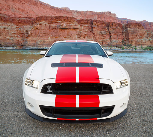 MST 04 RK0051 01 © Kimball Stock 2013 Ford Mustang Shelby GT500 White With Red Stripes Front View On Pavement By Water And Red Rock
