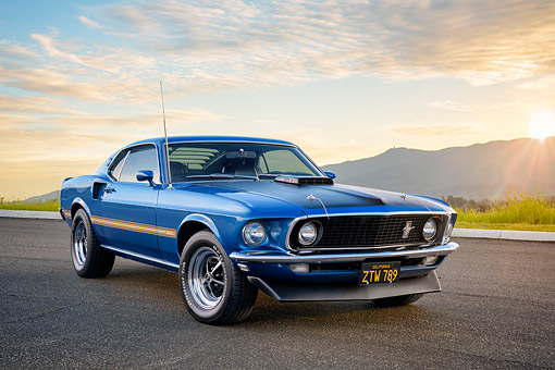 MST 04 RK0053 01 © Kimball Stock 1969 Ford Mustang Mach I Cobra Jet 428 Blue 3/4 Front View On Pavement By Mountains