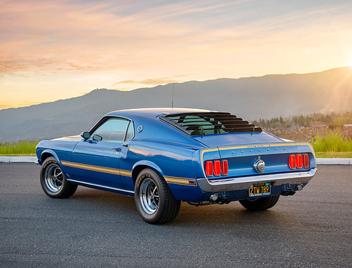 MST 04 RK0055 01 © Kimball Stock 1969 Ford Mustang Mach I Cobra Jet 428 Blue 3/4 Rear View On Pavement By Mountains