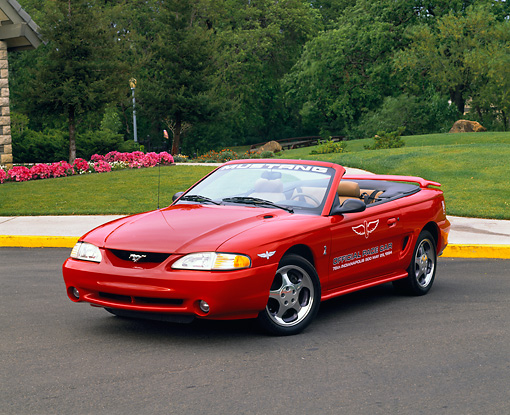 MST 04 RK0007 04 © Kimball Stock 1994 Ford Mustang Cobra Indy Pace Car Convertible Red 3/4 Front View On Pavement
