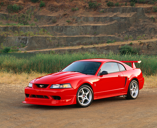 MST 04 RK0011 02 © Kimball Stock 2000 Ford Mustang Cobra R Red 3/4 Front View On Dirt