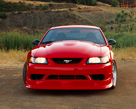MST 04 RK0016 03 © Kimball Stock 2000 Ford Mustang Cobra R Red Head On Shot On Dirt