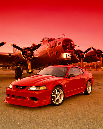 MST 04 RK0030 11 © Kimball Stock 2000 Ford Mustang Cobra R Red 3/4 Front View On Pavement By Plane Red Sky