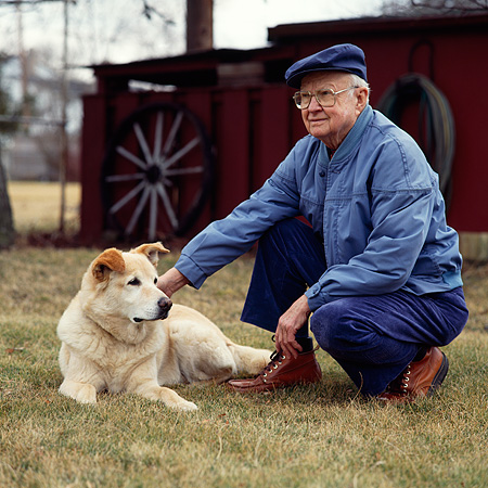 PEO 02 RS0001 01 © Kimball Stock Elder Man With Dog On Grass