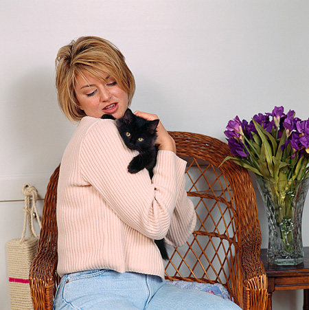 PEO 03 RS0053 01 © Kimball Stock Woman Holding Black Kitten
