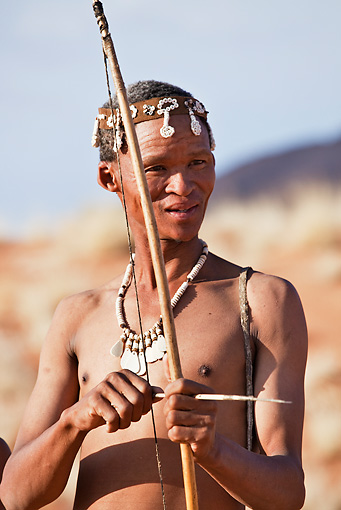 PEO 08 MH0001 01 © Kimball Stock Portrait Of San Hunter Armed With Traditional Bow And Arrow Namibia
