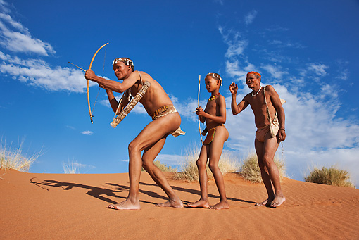 PEO 08 MH0003 01 © Kimball Stock San Hunter Adults Passing Down Hunting Techniques To Boy Namibia