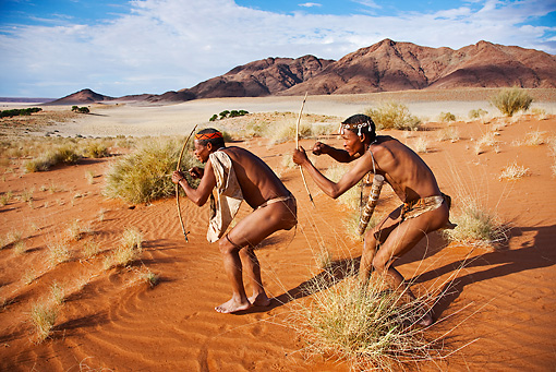 PEO 08 MH0004 01 © Kimball Stock Two San Hunters Armed With Traditional Bow And Arrow Namibia