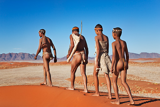 PEO 08 MH0010 01 © Kimball Stock San Hunters Walking With Traditional Bow And Arrows Namibia