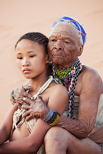 PEO 08 MH0017 01 © Kimball Stock Elderly San Woman Embracing Young Girl Namibia