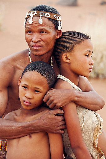 PEO 08 MH0022 01 © Kimball Stock Portrait Of San Father Embracing His Children Namibia