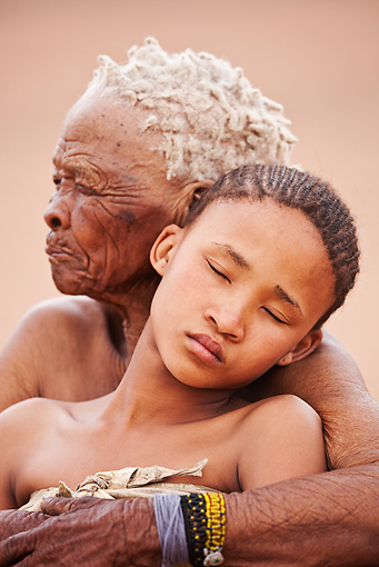 PEO 08 MH0024 01 © Kimball Stock Elderly San Woman Embracing Young Girl Namibia