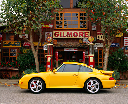 POR 01 RK0011 07 © Kimball Stock 1996 Porsche Twin Turbo Yellow Profile By Old Store