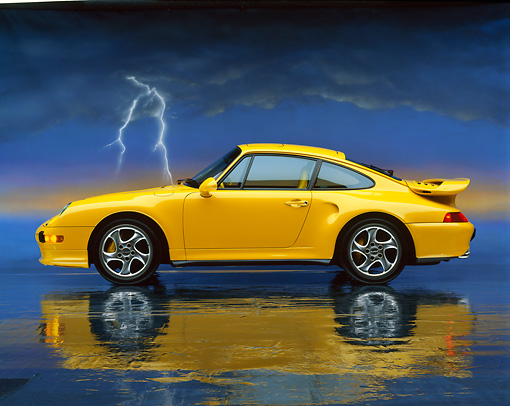 POR 02 RK0001 09 © Kimball Stock 1997 Porsche Turbo S Yellow Profile View On Mylar Floor Studio
