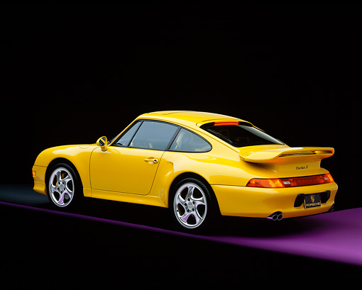 POR 02 RK0004 06 © Kimball Stock 1997 Porsche Turbo S Yellow Rear 3/4 View On Purple Floor Studio