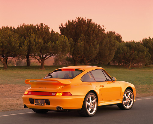 POR 02 RK0015 03 © Kimball Stock 1997 Porsche Turbo S Yellow Rear 3/4 View On Pavement