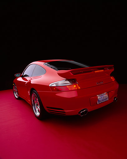 POR 03 RK0131 10 © Kimball Stock 2003 Porsche Turbo X50 Red Wide Angle 3/4 Rear View On Red Floor Studio