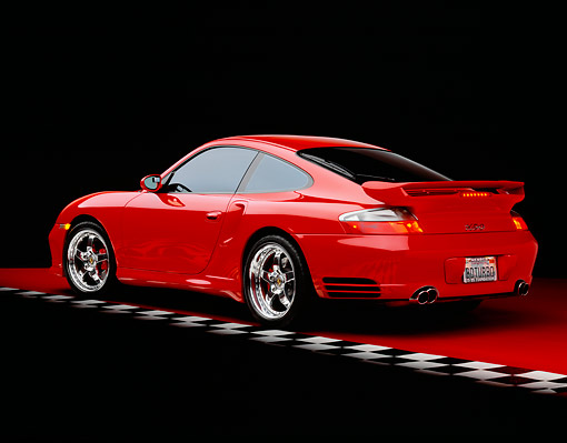 POR 03 RK0139 06 © Kimball Stock 2003 Porsche Turbo X50 Red Rear 3/4 View On Red Floor Checkered Line Studio