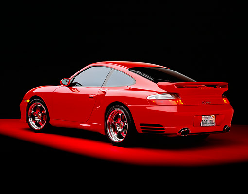 POR 03 RK0140 06 © Kimball Stock 2003 Porsche Turbo X50 Red Rear 3/4 View On Red Floor Studio