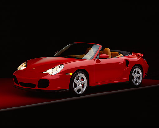 POR 03 RK0143 01 © Kimball Stock 2004 Porsche Turbo Cabriolet Red 3/4 Front View On Red Floor Gray Line Studio