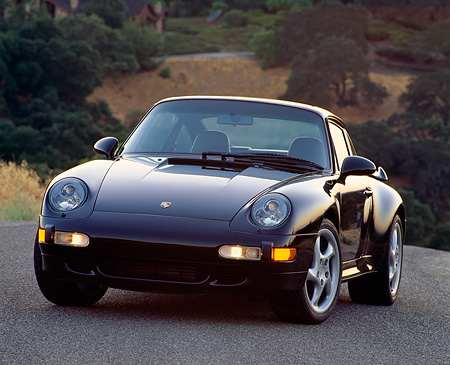 POR 03 RK0001 08 © Kimball Stock 1996 Porsche Turbo Blue 3/4 Front View On Pavement Hill