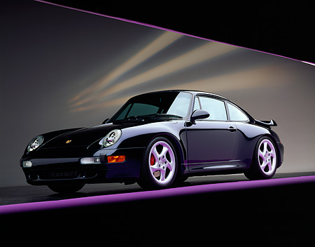 POR 03 RK0013 04 © Kimball Stock 1996 Porsche Turbo Midnight Blue Low 3/4 Front View On Purple Line Studio