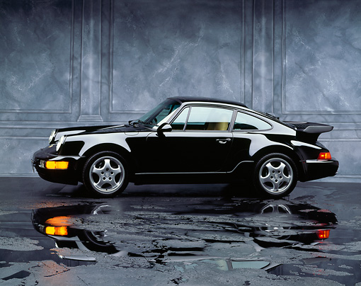 POR 03 RK0015 03 © Kimball Stock 1992 Porsche 911 Turbo Black 3/4 Front View Studio