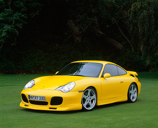 POR 03 RK0128 09 © Kimball Stock 2001 Porsche R Turbo Yellow Front 3/4 View On Grass